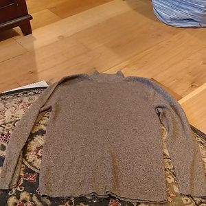 Speckled brown sweater.